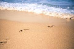 Footprint in a beach sand from sea. Footprint in a beach sand from sea in a summer stock photography