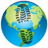 Footprint on the earth globe Royalty Free Stock Image