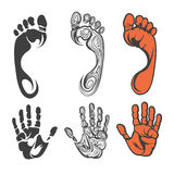 Footprint and hand print silhouettes Stock Images