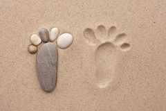 The footprint made up of stones Stock Photos