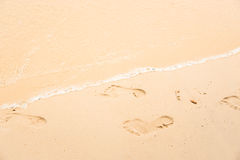 Footprint Relax in summer time on sand beach island nature Royalty Free Stock Photo