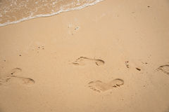 Footprint relax in summer time on sand beach island nature Royalty Free Stock Image