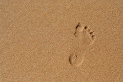 Footprint in sand. Bare footprint in smooth sand Royalty Free Stock Image