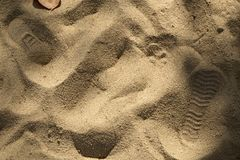 Footprint on sand beach. Walking on the beach Royalty Free Stock Photography