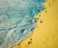 Footprint on sand. With foam royalty free stock photography