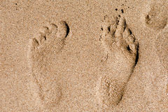 Footprint in the sand macro Stock Photos