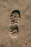 Footprint shoe on beach brown sand texture print Stock Image