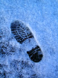 Footprint in Snow. Vertical photo of footprint in the snow Royalty Free Stock Photos