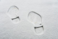 Footprint in the snow. Winter concept Stock Photos