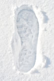 Footprint on snow Stock Photo