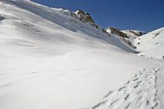 Footprint on snow Stock Photos