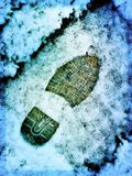 Footprint in the snow. Snow covered lawn with footprint Royalty Free Stock Photography