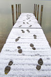 Footprint in Snow on Dock Stock Image