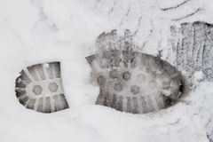 Footprint on the snow. Footprint of man's boot on the first snow Royalty Free Stock Image