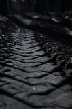 Footprint of the tire in the mud Stock Photo