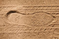 Footprint tread shoes and tires on the sand royalty free stock image