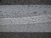Footprint wheel in the asphalt. Footprint wheel in the grey asphalt Stock Images