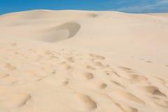 Footprint on white sand dune desert in Mui Ne Stock Photos