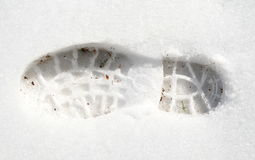 Footprint in white snow Royalty Free Stock Image