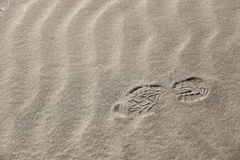 Footprint and wind ripple. One day when I visited the coast, I photographed the footprints. Since I found the footprints on the sands of wind ripple Royalty Free Stock Photo