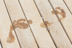 Footprint on wood plank. Wet footprint on wood plank on the beach royalty free stock photography