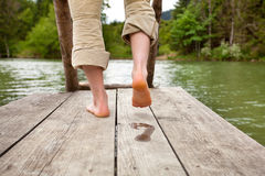 Footprint on wooden pier Royalty Free Stock Photos