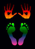 Footprints. Illustration of colored hand and foot prints on black Royalty Free Stock Photos