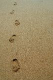 Footprints. Shot of some footprints in the sand at the Beach royalty free stock photos