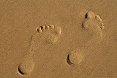 Footprints. Two footprints in the sand Stock Photo