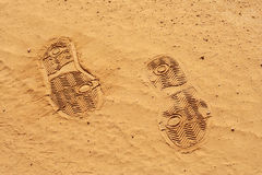 Footprints. A yellow footprints in the mud Stock Photos