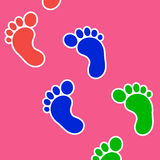 Footprints background. Human colorful footprints on a pink background Stock Photography