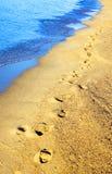 Footprints on the beach Stock Photos