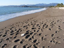 Footprints on Beach. Footprints disturb the fresh sand after a storm at Calis Beach, Fethiye, Turkey Stock Photography