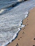 Footprints on the beach Stock Image