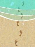 Footprints on the beach Royalty Free Stock Photo