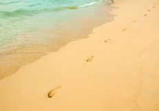 Footprints in the beach Royalty Free Stock Photos