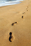 Footprints on beach sand. Royalty Free Stock Photos
