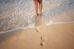 Footprints on beach. Stock Images