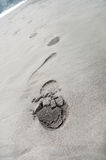 Footprints on the beach sand Stock Image
