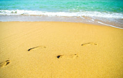 Footprints on the beach sand Royalty Free Stock Photo