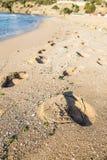 Footprints on beach Stock Photography