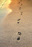 Footprints on the beach and sea wave Royalty Free Stock Photo