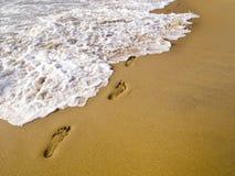 Footprints at the beach Stock Photo