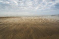 Footprints on beach Summer sunset landscape Stock Photo