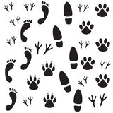 Footprints. Black footprints of animals and humans on a white background vector illustration
