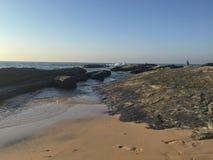 Footprints - Cavaleiros Beach, Macae, RJ. Footprints ahead of the morning tide in Macae, Rio de Janeiro, Brazil stock photography