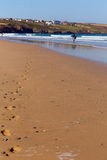 Footprints on Crantock virgin beach North Cornwall England UK near Newquay for early morning surfing Stock Photos