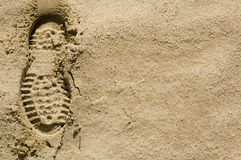 Footprints in the desert sand left. Single footprint impression in the desert sand on left of image Royalty Free Stock Photography