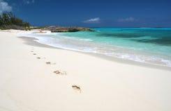 Footprints on the desrt beach Stock Image