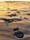 Footprints on the diamond beach in Iceland stock photo